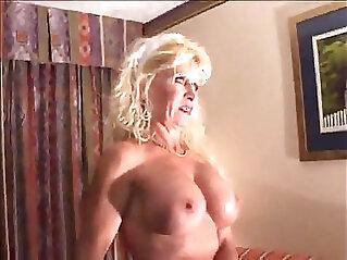 Busty Mature Bitch in Interracial Scene